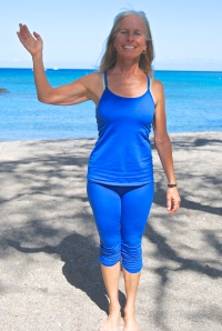 Calley O'Neill welcomes you to Anaehoomalu Bay for yoga on the beach.