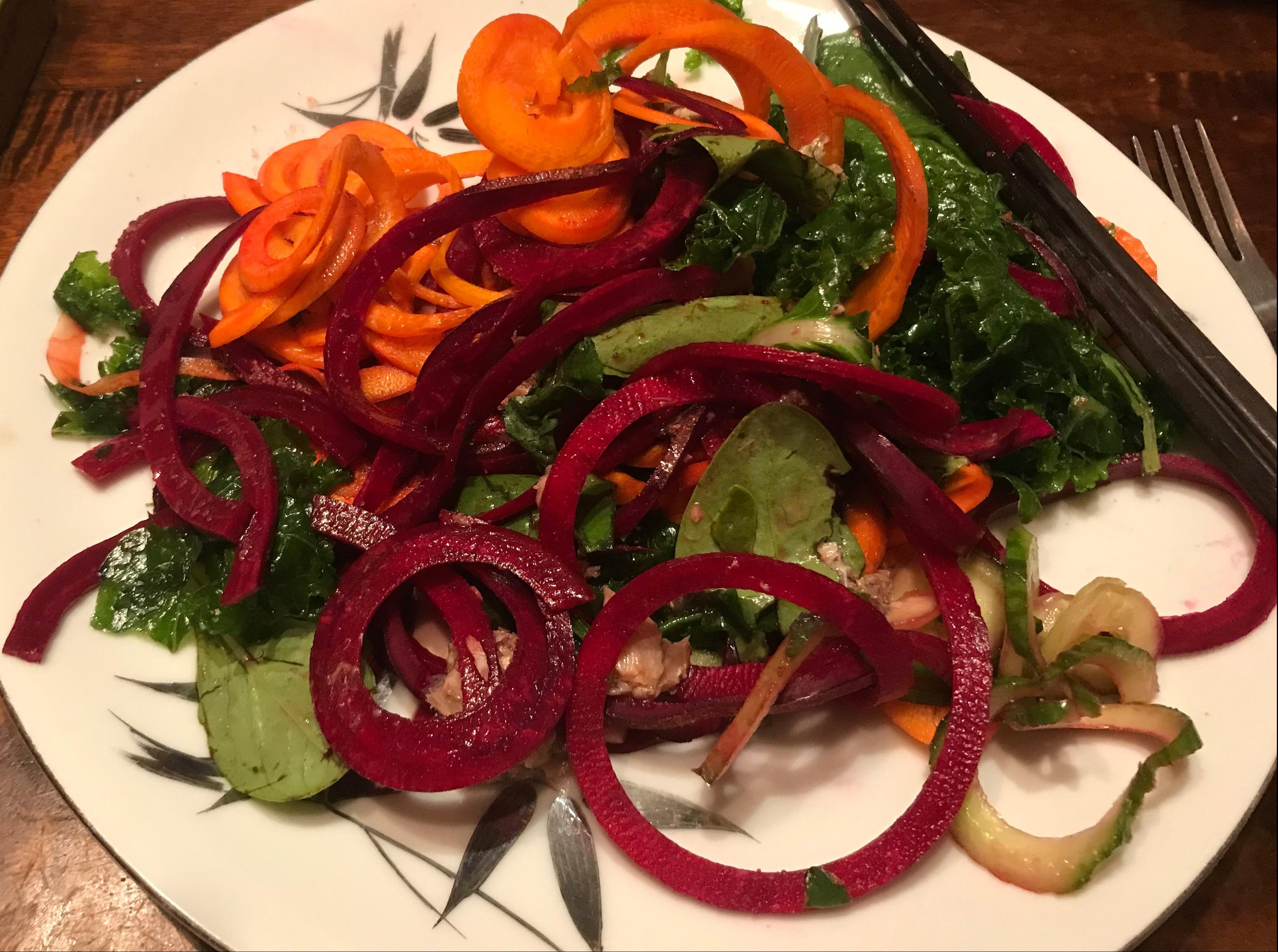 spiralized beets and carrots with massaged kale and topped with sardines! Yummmmm...